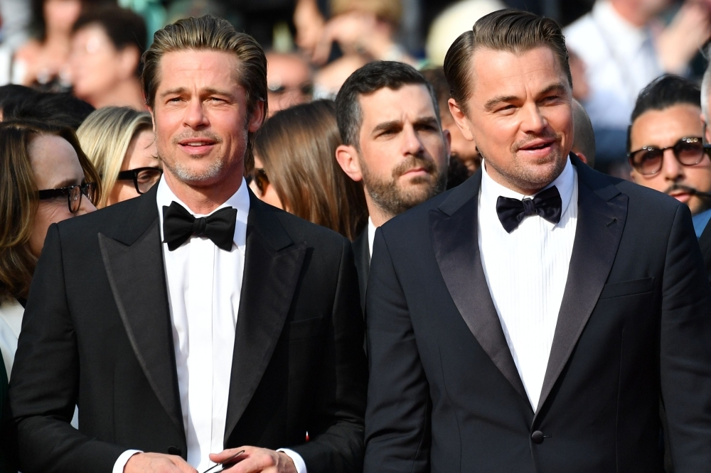US actor Brad Pitt and US actor Leonardo DiCaprio arrive for the screening of the film