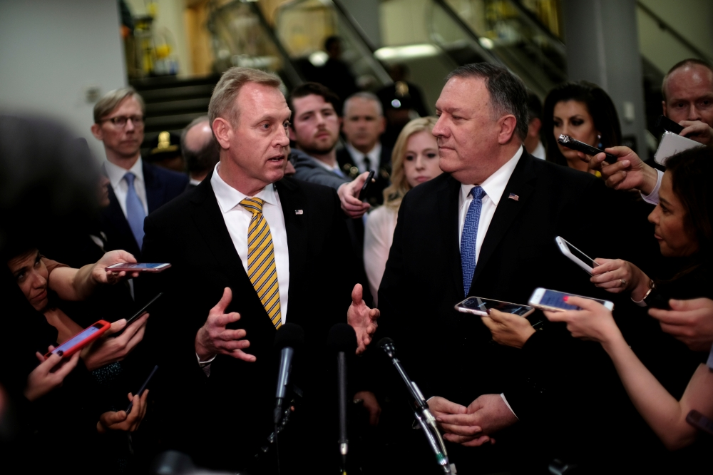 Acting US Defense Secretary Patrick Shanahan, left, and US Secretary of State Mike Pompeo speak to reporters after briefing senators on Iran in Washington. — Reuters