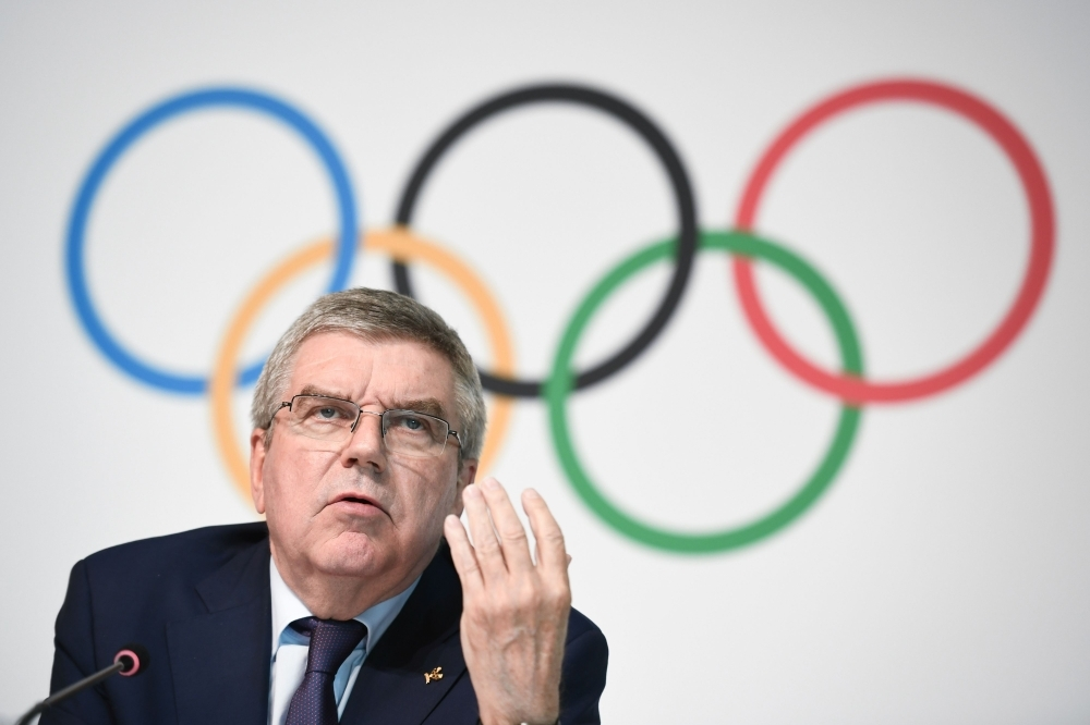 International Olympic Committee (IOC) president Thomas Bach gestures as he speaks during a press conference following an IOC executive committee on boxing at the 2020 Olympic Games at the sports governing body's headquaters on Wednesday in Lausanne. International Olympic Committee executives recommended that boxing's governing body be stripped of its right to organise the event at Tokyo 2020, but said the sport should still feature at the Games. — AFP