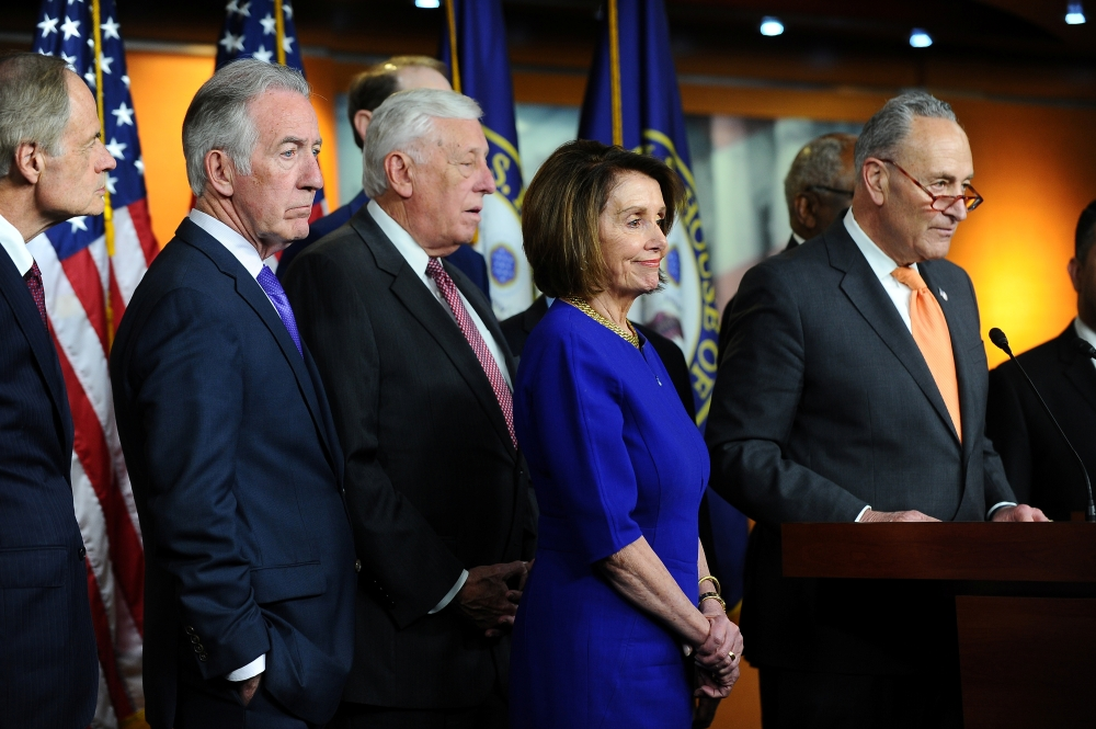 US Senate Democratic Leader Chuck Schumer (D-NY) (R), House Speaker Nancy Pelosi (D-CA), and other Democratic lawmakers speak to Capitol Hill reporters after a planned White House meeting with US President Donald Trump to discuss infrastructure was cut short in Washington, US,on Wednesday.— Reuters