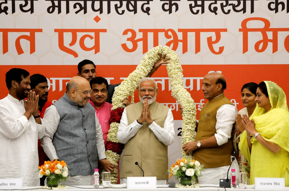 India's Prime Minister Narendra Modi gestures as he is presented with a garland during a thanksgiving ceremony by Bharatiya Janata Party (BJP) leaders to its allies at the party headquarters in New Delhi, India, on Tuesday. — Reuters