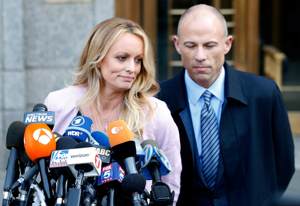 Stormy Daniels, whose real name is Stephanie Clifford, speaks to media along with lawyer Michael Avenatti (R) outside federal court in the Manhattan borough of New York City, New York, US, in this file photo. — Reuters