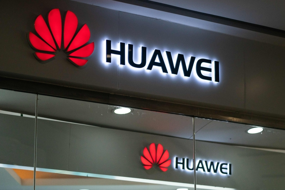 A Huawei logo is displayed at a retail store in Beijing on Thursday. Chinese telecom giant Huawei says it could roll out its own operating system for smartphones and laptops in China by the autumn after the United States blacklisted the company. — AFP