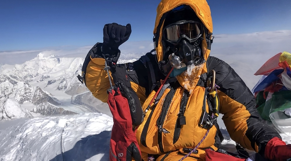 This handout photo released by Summits with a Purpose shows South African climber Saray Khumalo posing at the top of Mount Everest after her summit, becoming the first black African woman achieving the feat. The business executive who became the first black African woman to climb Mount Everest said that knowing her climb would be in the record books helped her push on to the top. — AFP