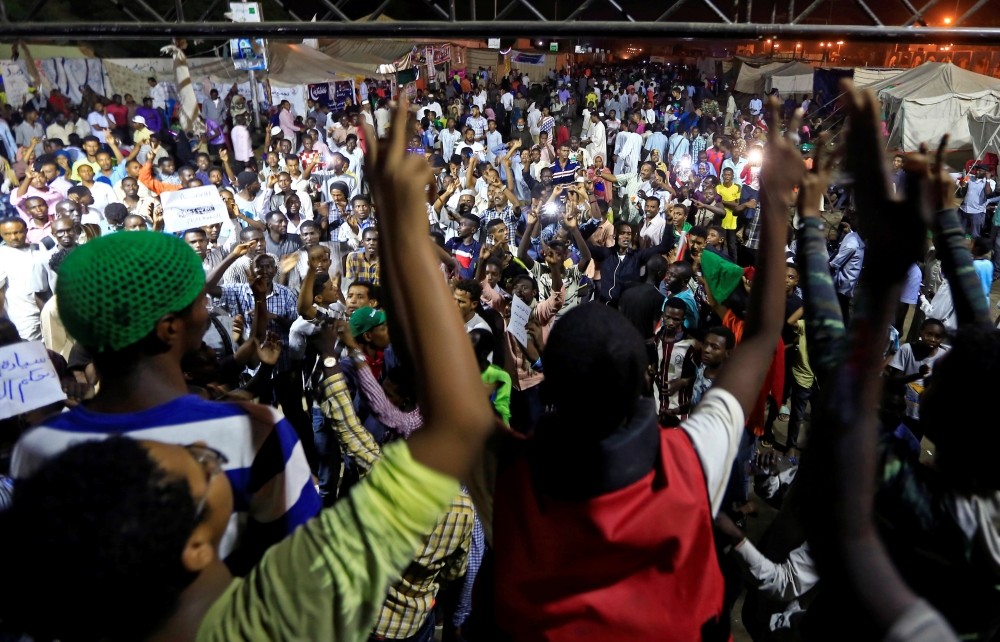 Sudanese protesters attend a demonstration along the streets of Khartoum, Sudan, on Wednesday. — Reuters