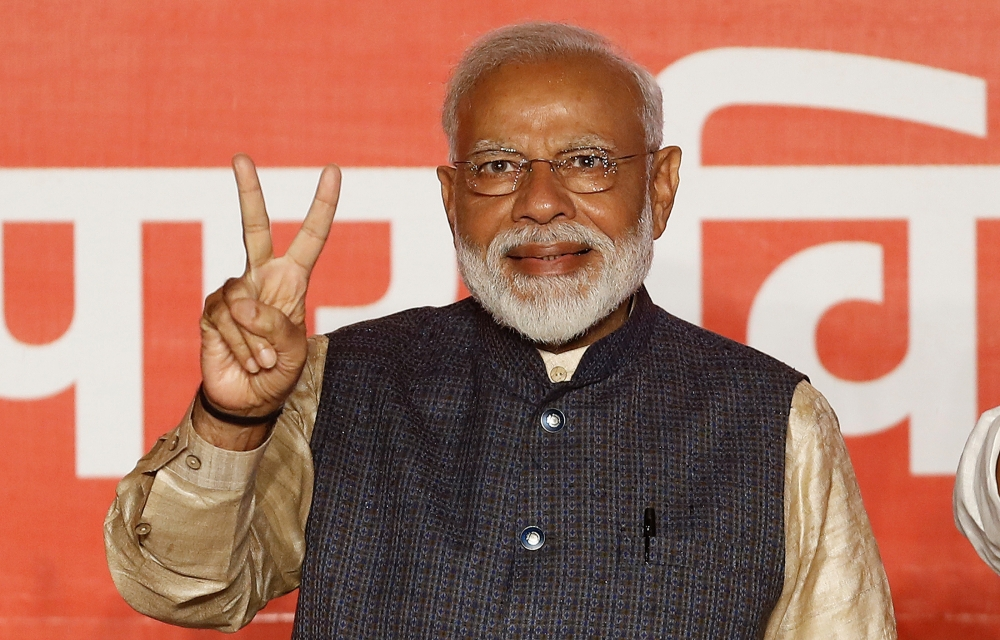 Indian Prime Minister Narendra Modi gestures toward his supporters after the election results at Bharatiya Janata Party (BJP) headquarter in New Delhi on Thursday. — Reuters