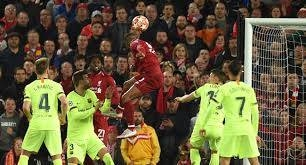 Liverpool's Dutch midfielder Georginio Wijnaldum (C) heads the ball to score their third goal against Barcelona on May 7, 2019, in the Champions League tie at Anfield in this file photo.