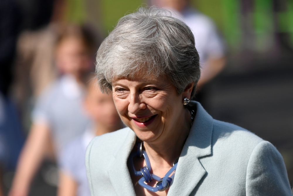 Britain's Prime Minister Theresa May arrives to vote in the European Parliament Elections, taking place despite Brexit uncertainty, in Sonning, Britain, on Thursday. — Reuters