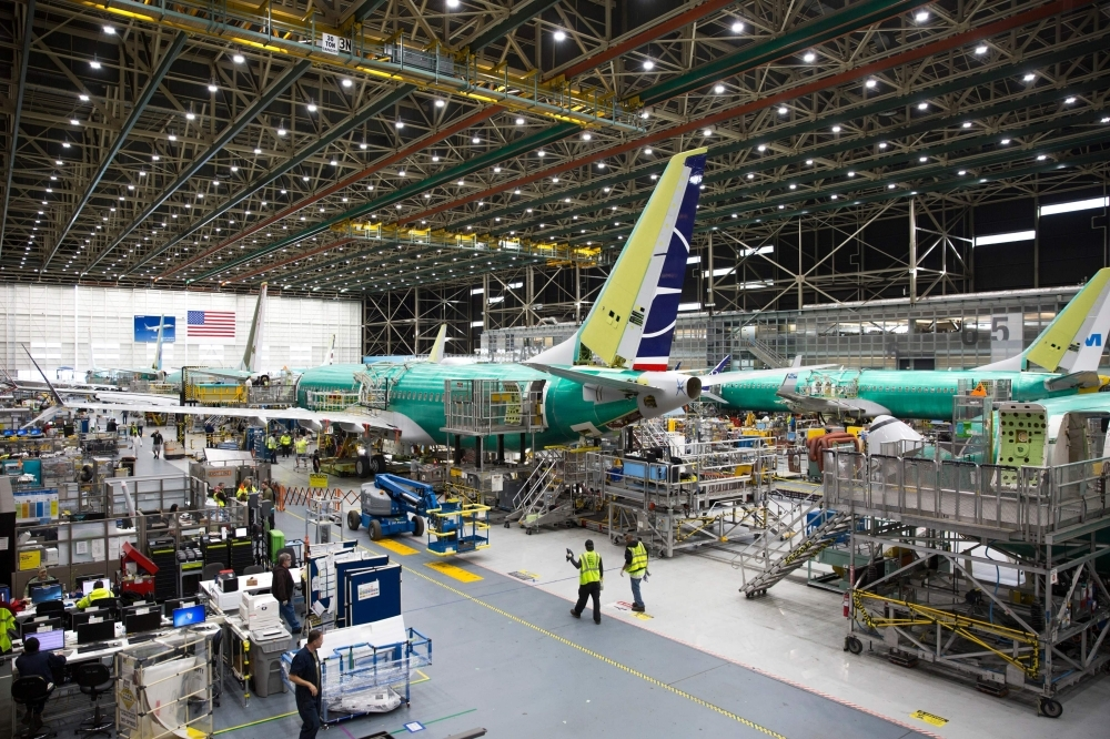 In this file photo taken on March 27, 2019, employees work on Boeing 737 MAX airplanes at the Boeing Renton Factory in Renton, Washington. — AFP
