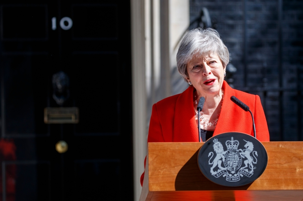 Britain's Prime Minister Theresa May announces her resignation outside 10 Downing street in central London on May 24, 2019. — AFP