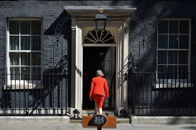 Britain's Prime Minister Theresa May leaves after she announces her resignation outside 10 Downing street in central London on May 24, 2019. — AFP