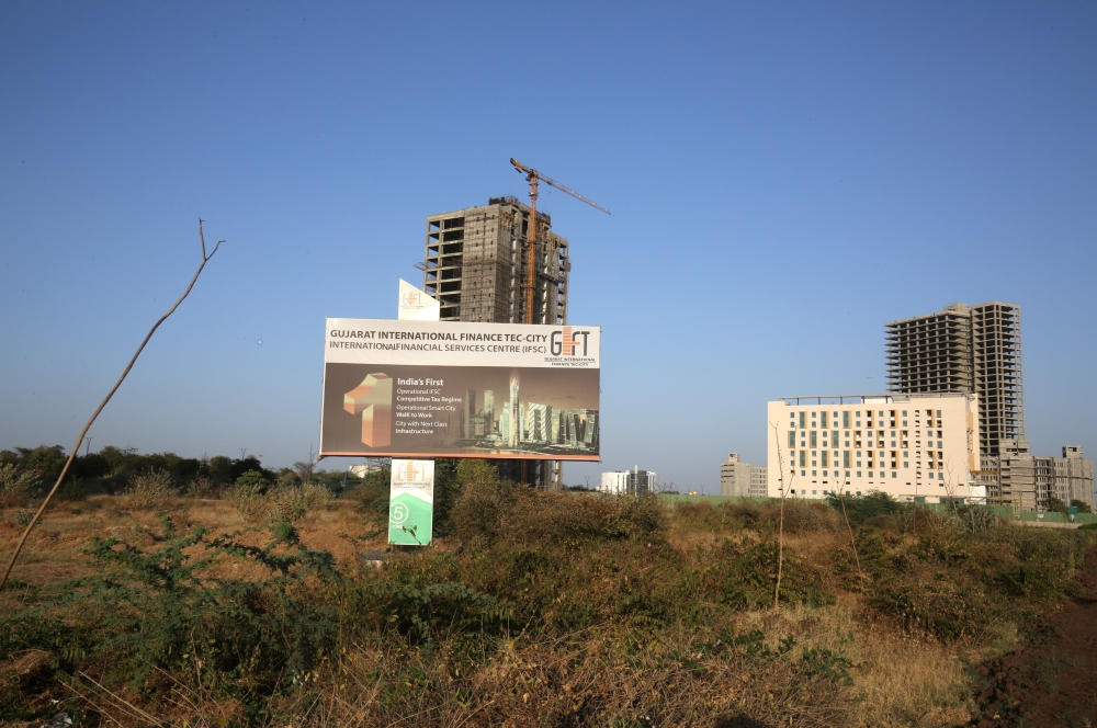 A billboard stands in front of buildings under construction at the Gujarat International Finance Tec-City (GIFT) at Gandhinagar, in the western state of Gujarat, in this file photo. — Reuters