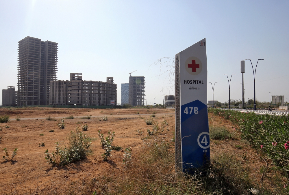 A signboard is pictured in front of buildings under construction at the Gujarat International Finance Tec-City (GIFT) at Gandhinagar, in the western state of Gujarat, in this file photo. — Reuters