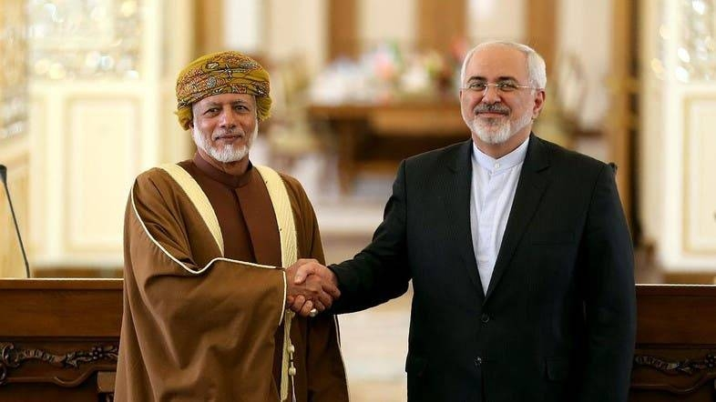 Javad Zarif (R) with Omani State Minister for Foreign Affairs Yussef Bin Alawi Bin Abdulla in Tehran. — AFP file photo