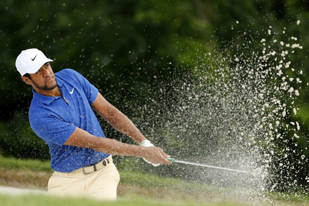 Tony Finau of the United States plays a shot from a bunker on the fifth hole during the first round of the Charles Schwab Challenge at Colonial Country Club on Thursday in Fort Worth, Texas. — AFP