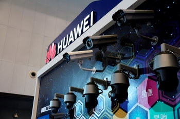 Huawei surveillance cameras are seen displayed at the security exhibition in Shanghai, China, on Friday. — Reuters