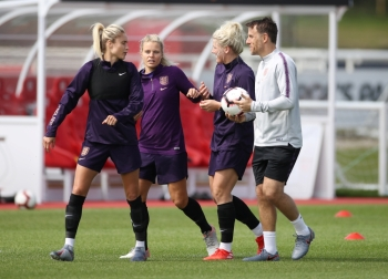 England manager Phil Neville with Millie Bright, Rachel Daly and Steph Houghton during training at the St. George's Park, Burton upon Trent, Britain, on Friday. — Reuters