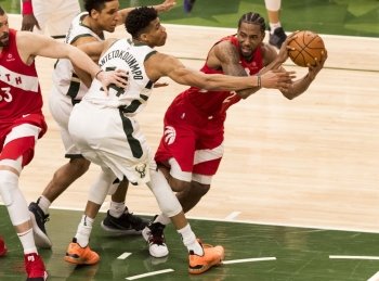 Toronto Raptors forward Kawhi Leonard (2) passes the ball as Milwaukee Bucks forward Giannis Antetokounmpo (34) defends during the fourth quarter in game five of the Eastern conference finals of the 2019 NBA Playoffs at Fiserv Forum. — Reuters