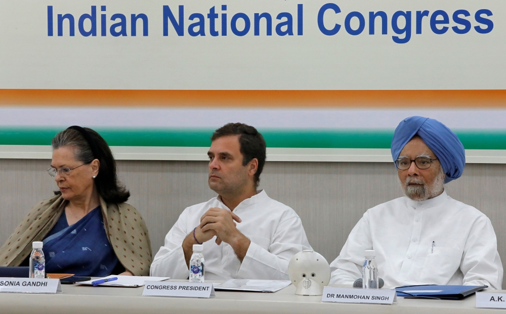 Rahul Gandhi, president of Congress party, his mother and leader of the party Sonia Gandhi and India's former prime minister Manmohan Singh attend a Congress Working Committee (CWC) meeting in New Delhi, Saturday. — Reuters