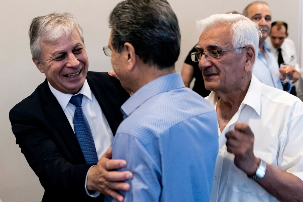 Cypriot Democratic Rally's (DHSY) candidate Lefteris Christoforou (1st-L) talks with supporters in Nicosia on Friday, on the last day of campaigning for the upcoming European Parliament elections. — AFP