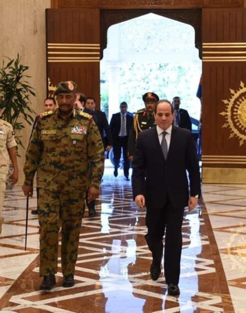 Egypt's President Abdel Fattah El-Sisi (right) receives Sudan's ruling military council chief Abdel Fattah Al-Burhan in Cairo on Saturday.