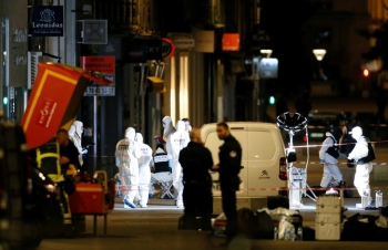 Forensic officers inspect the site of a suspected bomb attack in central Lyon, France May 24, 2019. - Reuters