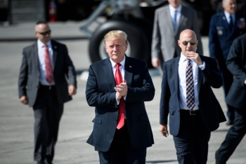 US President Donald Trump gestures as he walks on the tarmac at Elmendorf Air Force Base in Anchorage, Alaska, during a refuel stop en route to Japan on May 24. - AFP