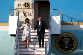 US President Donald Trump and first lady Melania Trump arrive aboard Air Force One at Tokyo Haneda Airport in Tokyo, Japan May 25.- Reuters