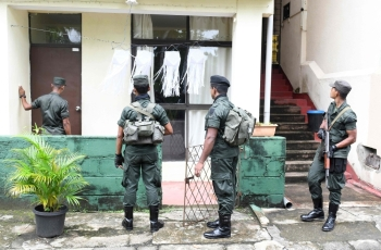 Sri Lankan soldiers inspect a house during special cordon-and-search operations in Colombo on Saturday. Sri Lanka's military launched a major hunt for remnants of a militant group which carried out the Easter suicide bombings that killed 258 people, officials said. — AFP
