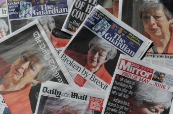 An arrangement of UK daily newspapers photographed as an illustration in London on Saturday shows front page headlines reporting on the resignation speech of Britain's Prime Minister Theresa May.  Beleaguered British Prime Minister Theresa May announced on Friday that she will resign on June 7 following a Conservative Party mutiny over her remaining in power. All the UK papers carried the story on their front pages with headlines like the Guardian's