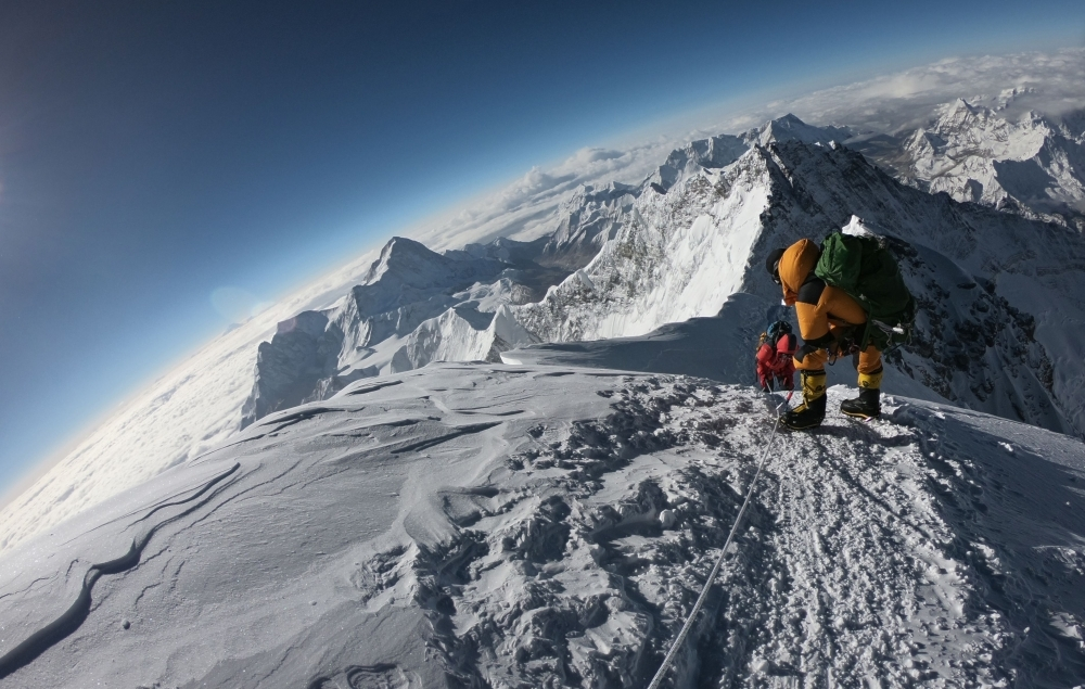 Mountaineers make their way to the summit of Mount Everest, as they ascend on the south face from Nepal, in this May 17, 2018 file photo. — AFP