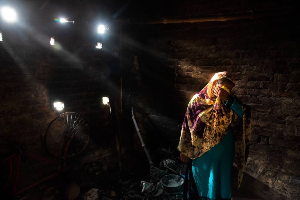 Sayida Bibi breaks down in her ransacked home in the Indian village of Bogakhali, in West Bengal state. The homes of both Hindus and Muslims were burned in what appeared to be politically motivated attacks. — Courtesy photo