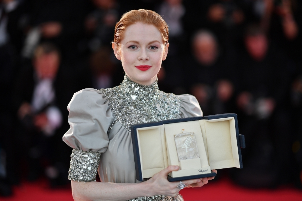 British actress Emily Beecham poses during a photo-call with her trophy after she won the Best Actress Prize for her part in