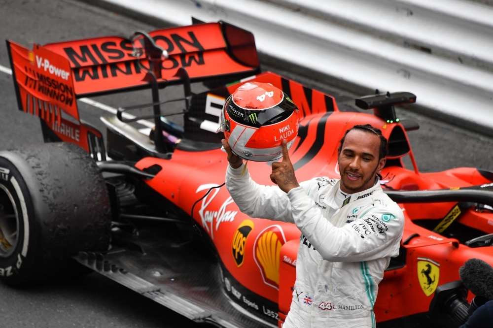 Mercedes' British driver Lewis Hamilton points at the name of late Formula One legend Niki Lauda on his helmet after winning the Monaco Formula 1 Grand Prix at the Monaco street circuit in Monaco on Sunday. — AFP