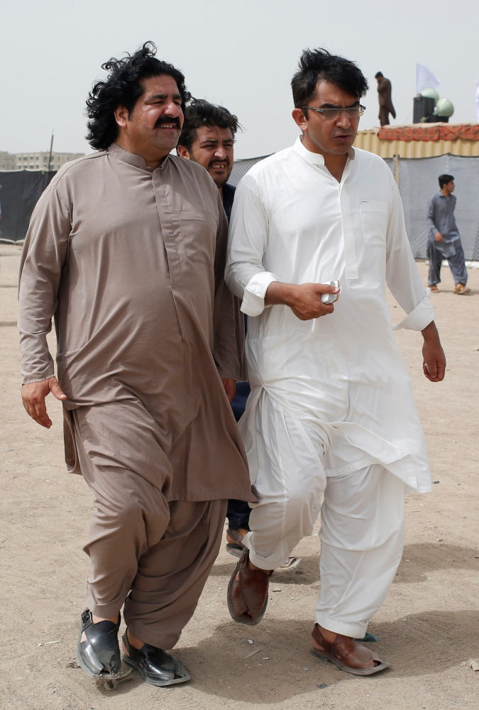 Ali Wazir, left, and Mohsin Dawar, leaders of the Pashtun Tahaffuz Movement (PTM) walk at the venue of a rally against, what they say, are human rights violations by security forces, in Karachi, Pakistan, in this May 13, 2018 file photo. — Reuters