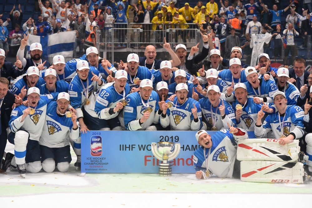 Finland's players celebrate with the trophy after the IIHF Men's Ice Hockey World Championships final between Canada and Finland in Bratislava, Slovakia, on Sunday. — AFP