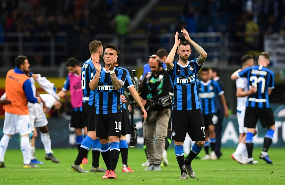 Inter Milan's players celebrate after winning the Italian Serie A football match between Inter Milan and Empoli at the San Siro stadium in Milan on Sunday. — AFP