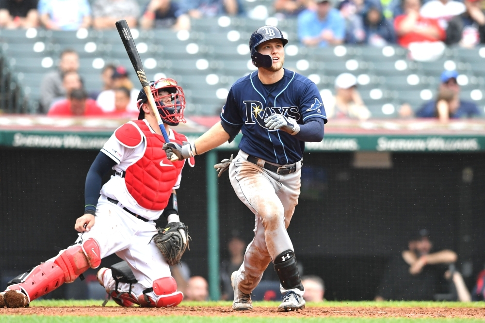 Austin Meadows #17 of the Tampa Bay Rays watches an RBI double to right during the ninth inning against the Cleveland Indians at Progressive Field in Cleveland, Ohio, on Sunday. — Reuters