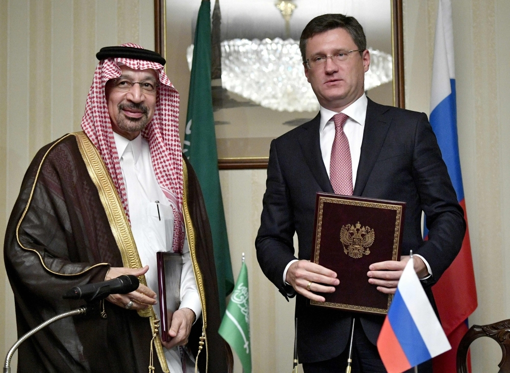Saudi Arabian Energy Minister Khalid Al-Falih (L) and Russian Energy Minister Alexander Novak (R) exchange documents during the 6th meeting of the Russian-Saudi Intergovernmental Commission on Trade, Economic and Scientific and Technical Cooperation in Moscow on Monday. — AFP