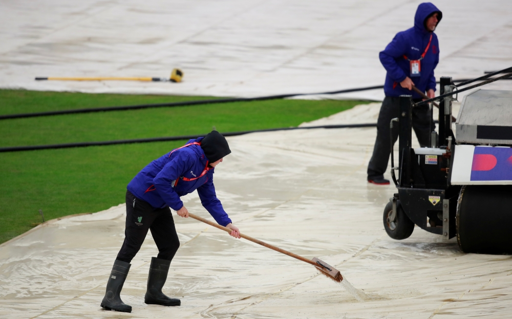 Cricket - ICC Cricket World Cup - Bangladesh v Sri Lanka - The County Ground, Bristol, Britain - June 11, 2019   Groundstaff work on the field during a rain delay   Action Images via Reuters/Andrew Couldridge