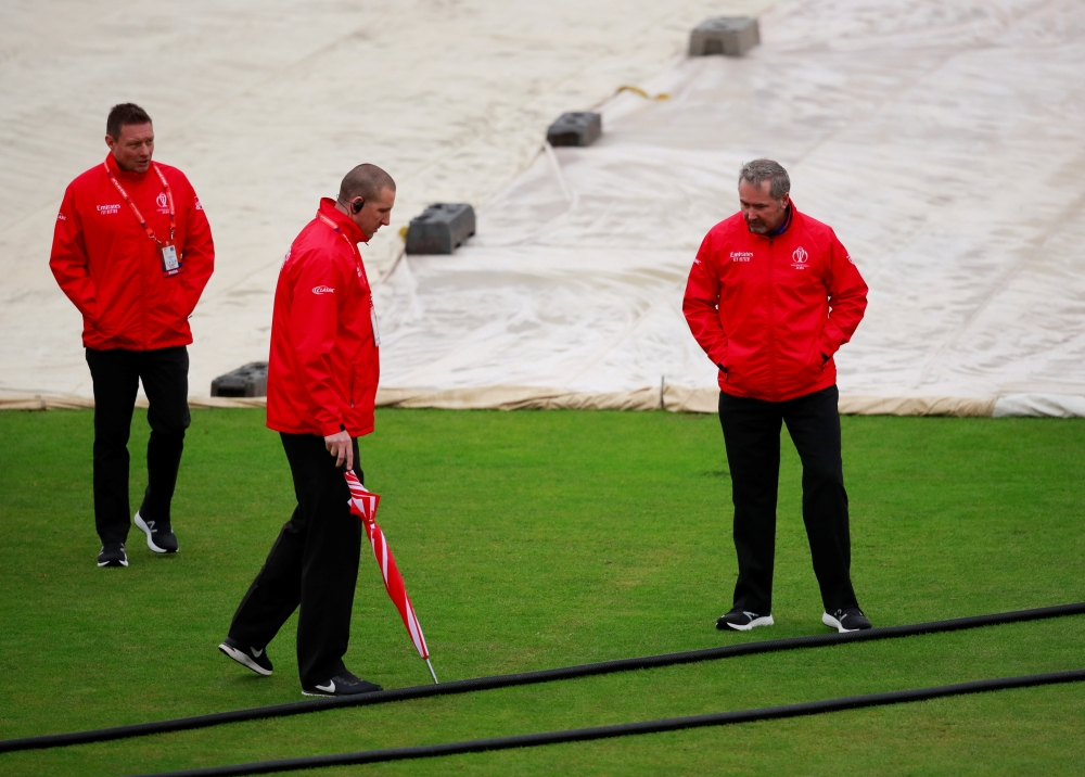 Cricket - ICC Cricket World Cup - Bangladesh v Sri Lanka - The County Ground, Bristol, Britain - June 11, 2019   Umpires inspect the pitch during a rain delay   Action Images via Reuters/Andrew Couldridge