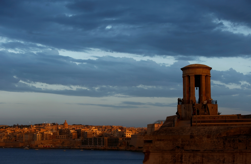 Tourists visit the Siege Bell War Memorial overlooking Grand Harbor at sunset in Valletta, Malta in this May 30, 2019 file photo. — Reuters