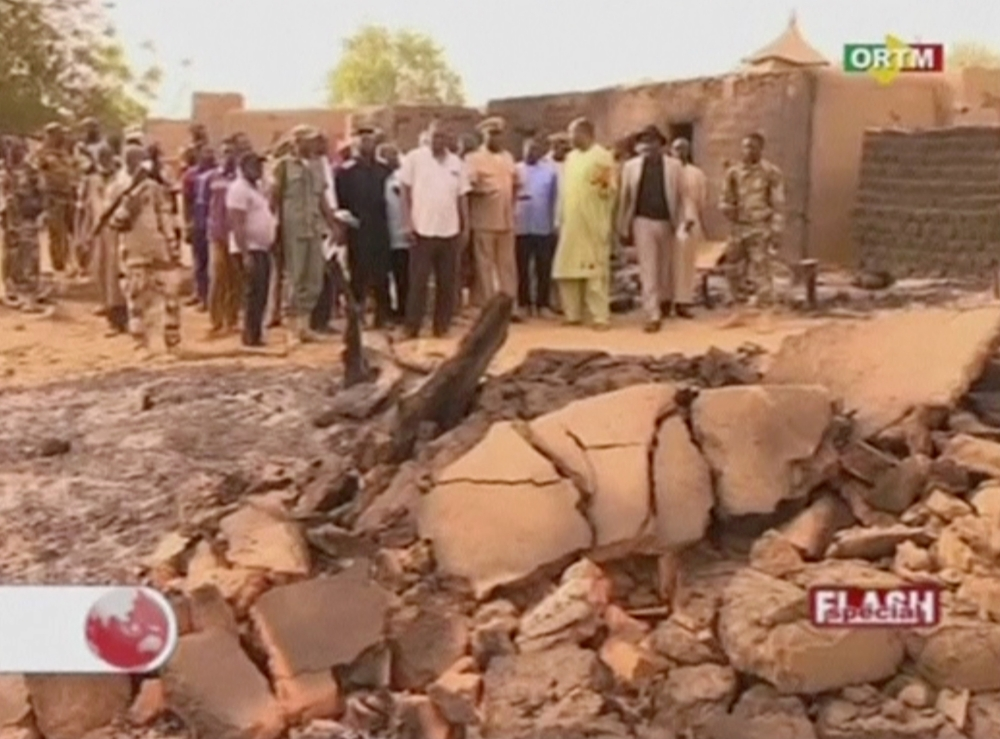 Officials inspect the damage at the site of an attack in the village of Sobame Da, in this still image taken from a footage released by ORTM and shot on Monday, Mali. — Reuters
