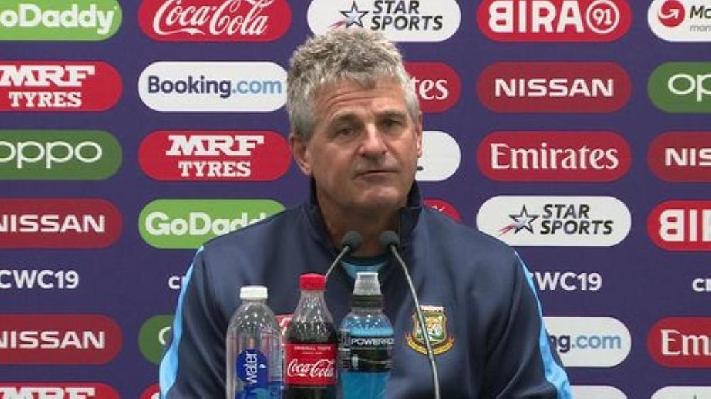 Bangladesh coach Steve Rhodes, seen at the post-match press conference, said that if men could land on the moon, the World Cup could include reserve days for group matches after the Tigers' fixture against Sri Lanka in Bristol was washed out completely on Tuesday.