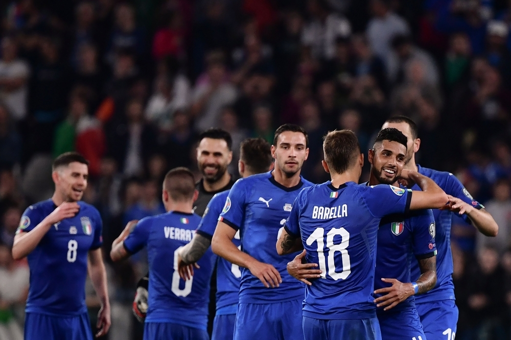 Italy's players celebrate at the end of the UEFA Euro 2020 qualification football match between Italy and Bosnia Herzegovina at the 'Allianz Stadium' in Turin, Italy, on Tuesday. — AFP