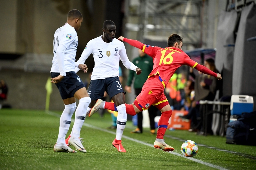 France's defender Ferland Mendy, center, vies with Andorra's forward Alex Martinez, right, during the UEFA Euro 2020 qualification football match between Andorra and France at the National stadium in Andorra La Vella, Andorra, on Tuesday. — AFP