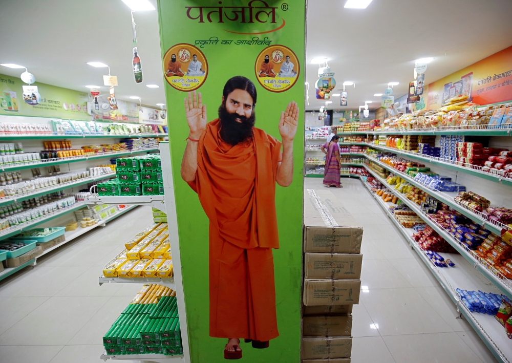 A hoarding with an image of Baba Ramdev is seen inside a Patanjali store in Ahmedabad, India, in this March 28, 2019 photo.  — Reuters