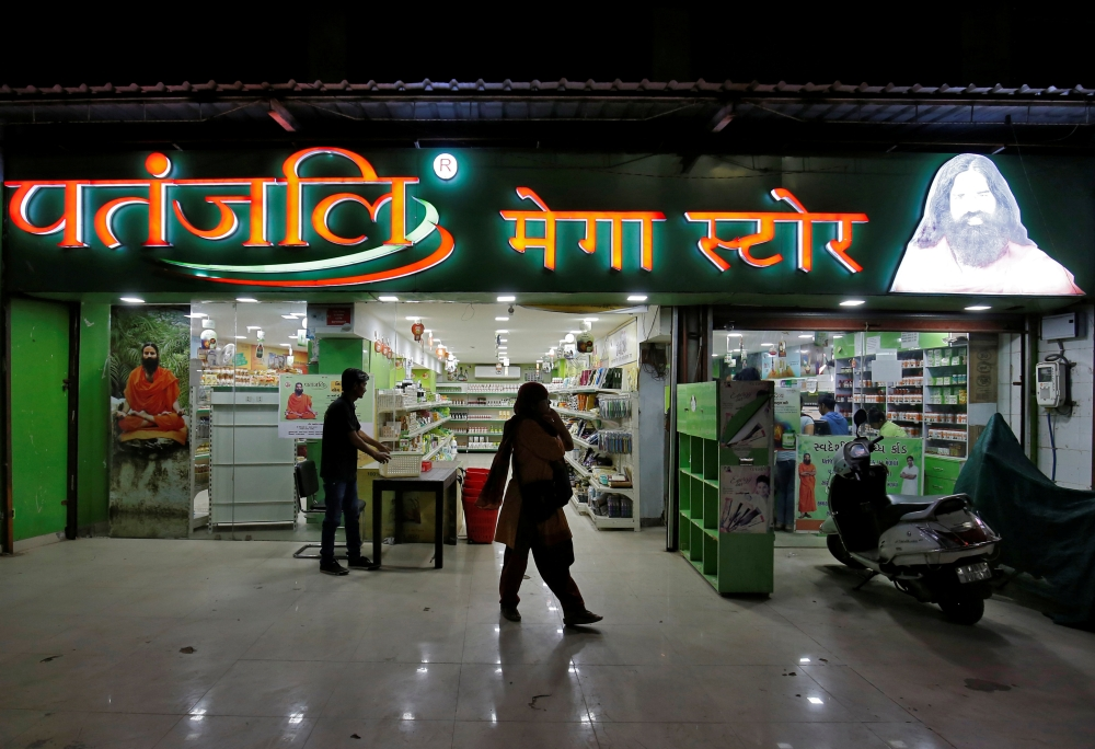 Customers walk outside a Patanjali store in Ahmedabad, India, in this March 28, 2019 photo.  — Reuters