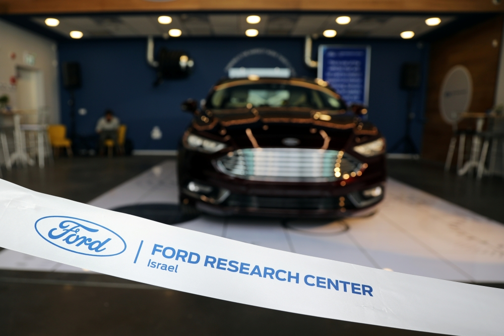 A ribbon with the logo of Ford Motor Co is seen during an event marking the opening of their research center in Tel Aviv, Israel on Wednesday. — Reuters