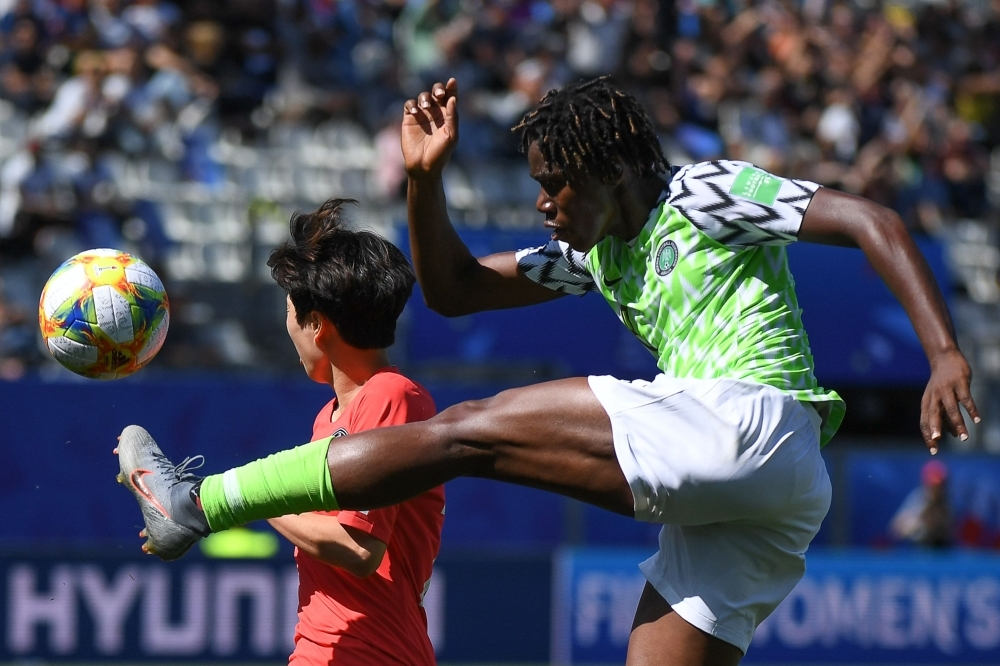 Nigeria's forward Asisat Oshoala (R) vies for the ball with South Korea's defender Kim Hye-ri during the France 2019 Women's World Cup Group A football match at the Alpes Stadium in Grenoble, central-eastern France, on Wednesday. — AFP